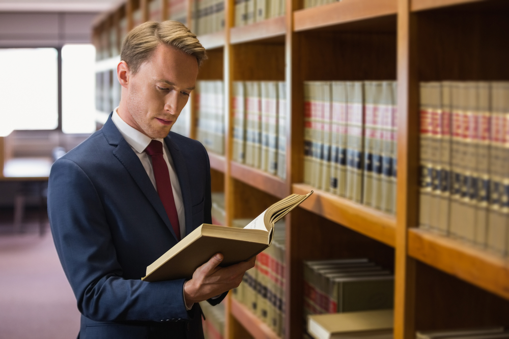 Handsome lawyer in the law library at the university-1